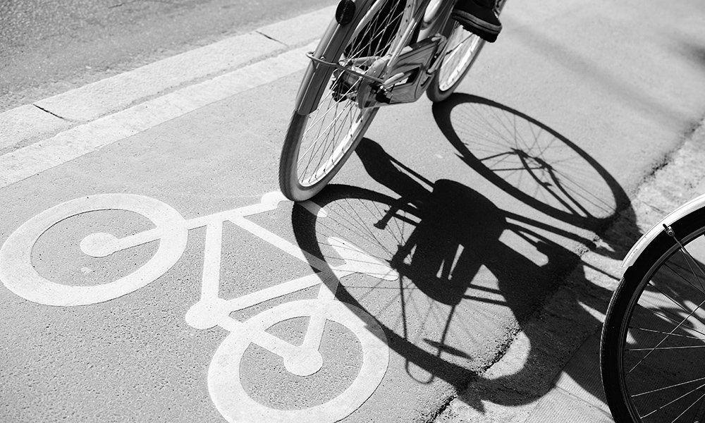 An image of a bicycle being ridden in a bike lane.