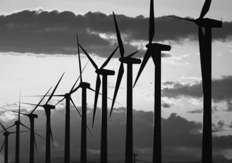 A black and white image of windmills.