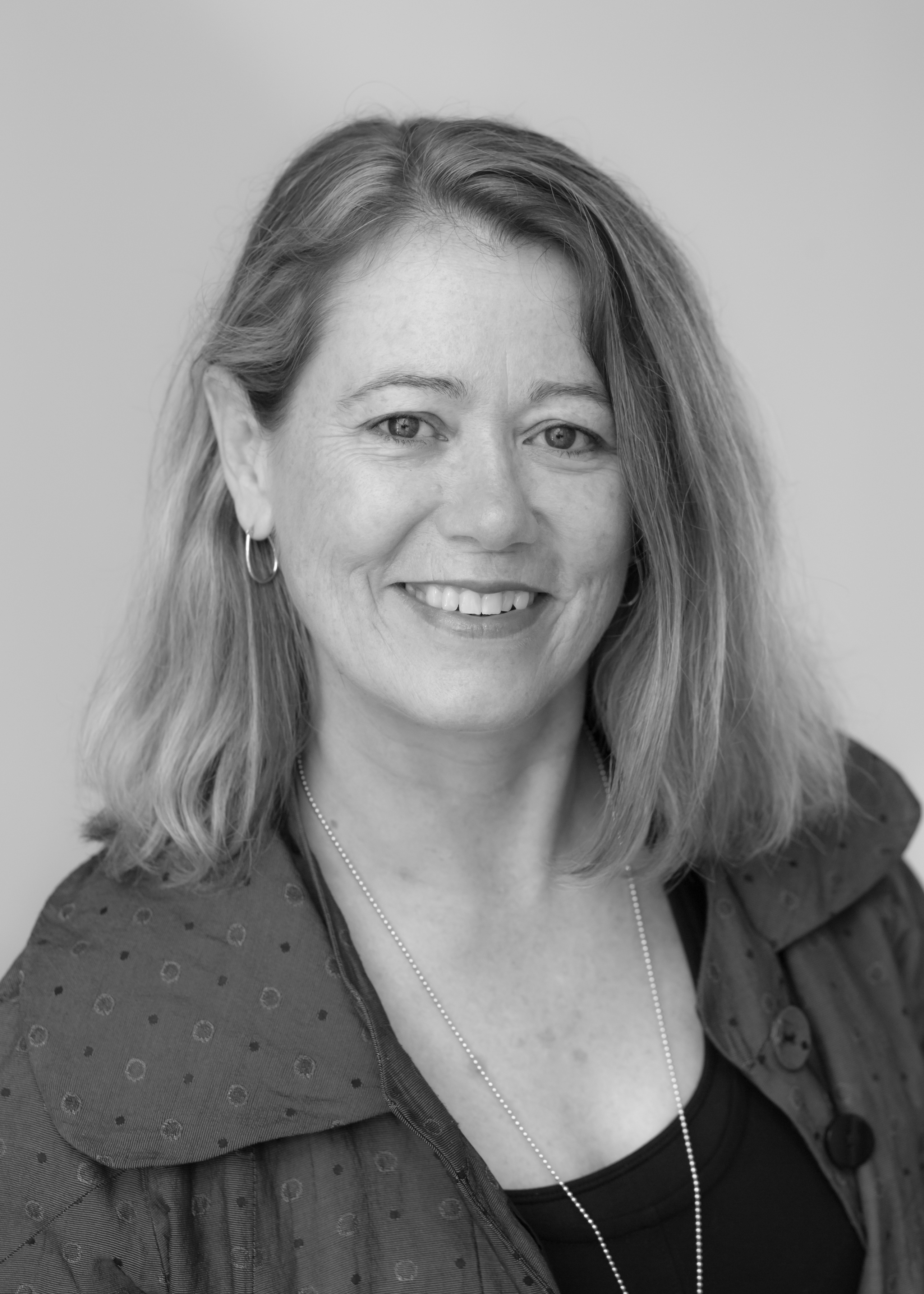 A black and white image of Michelle Brisbane, a financial planner at Ethical Investment Services.