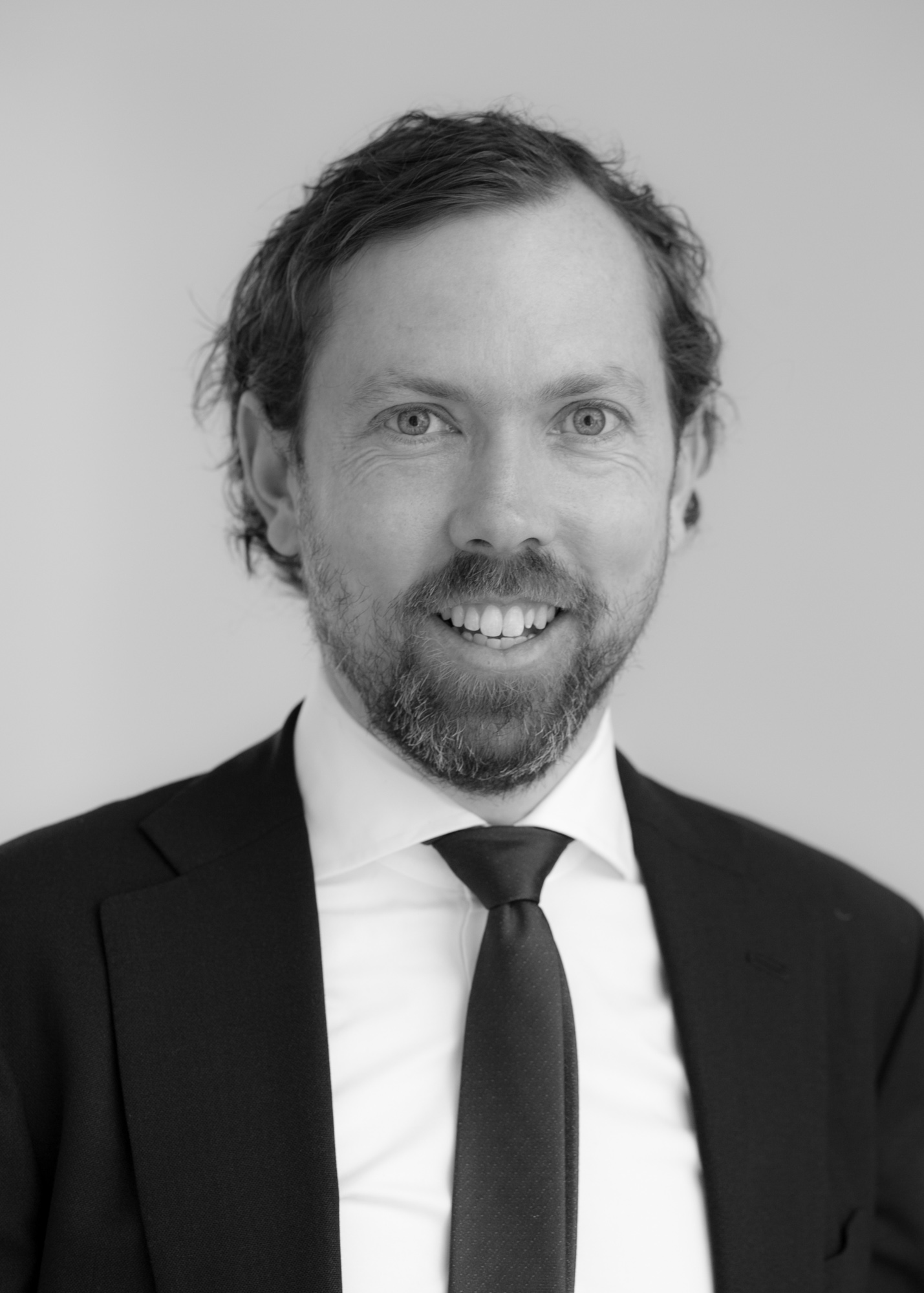 A black and white image of Tim Fitzpatrick, one of the financial advisers at Ethical Investment Services.