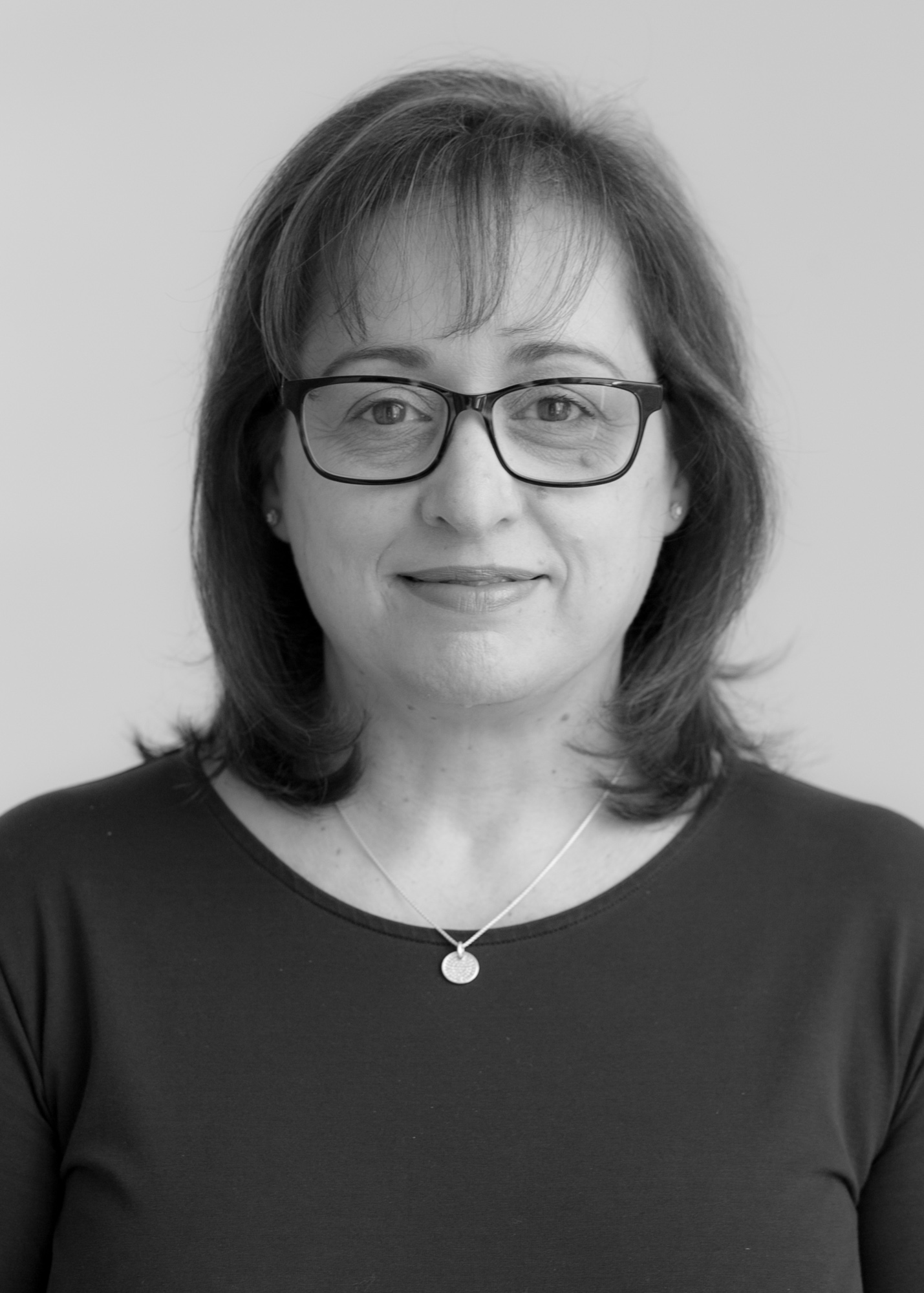 A black and white image of Rose Sinesio, Client Services Manager at Ethical Investment Services.
