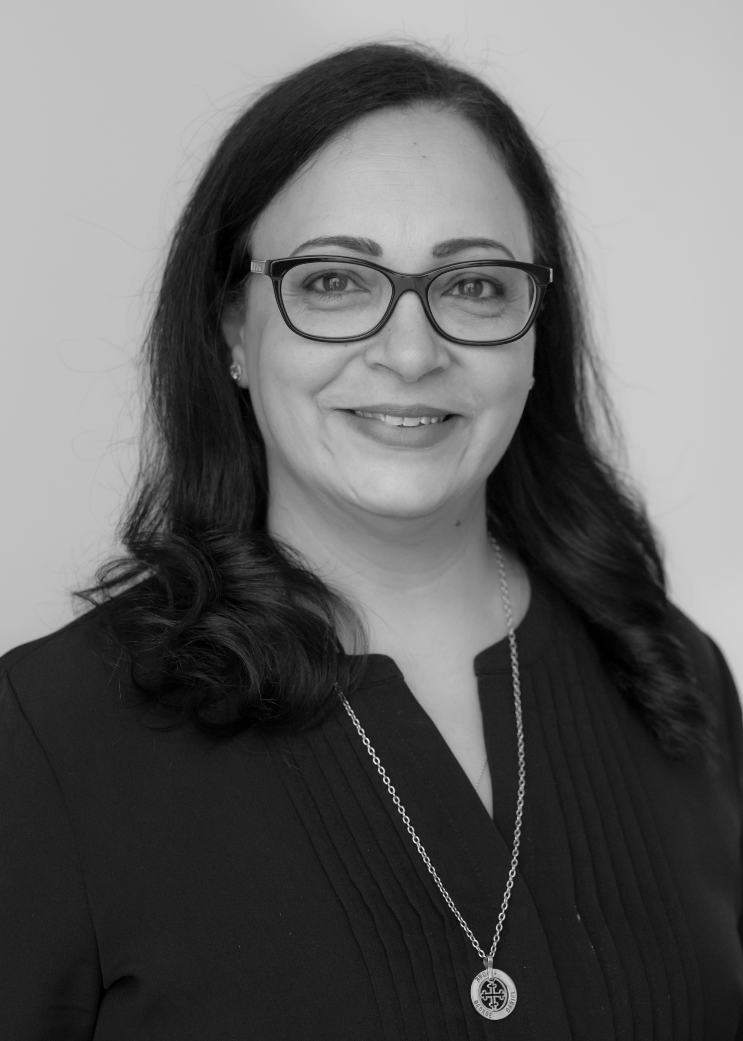 A black and white image of Amy Mikhael, Senior Paraplanner at Ethical Investment Services.