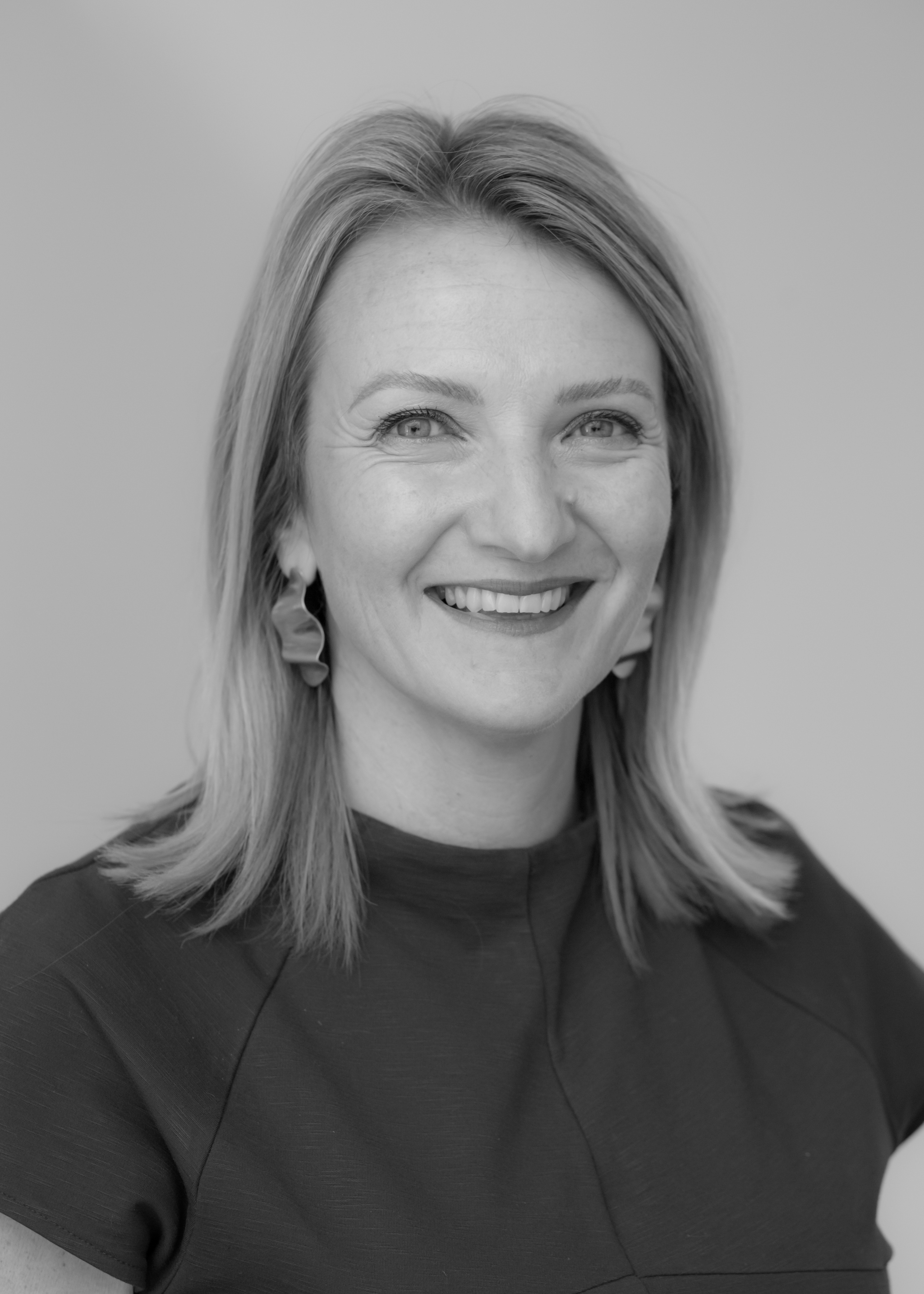A black and white image of Andrea McKay, one of the financial advisers at Ethical Investment Services.