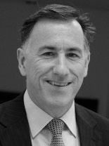 A black and white image of Adam Carey, a financial planner at Ethical Investment Services.