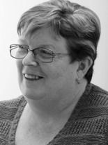 A black and white image of Diane Lowrie, Finance and Adminstration Manager at Ethical Investment Services.